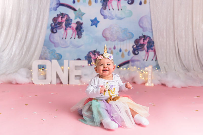 Baby smiling for first birthday photos