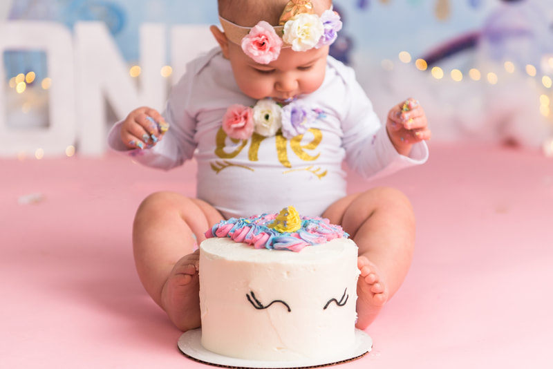 Baby smashing toes into cake in murrysville