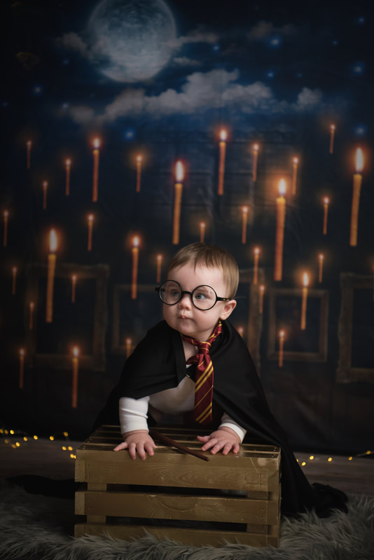 baby wearing harry potter glasses and robe